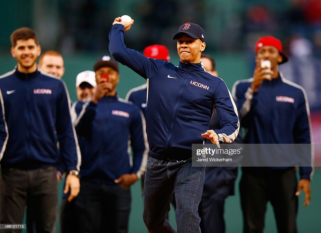 Shabazz Napier #13 of the national champion Connecticut Huskies throws out the first pitch prior to the game between the Boston Red Sox and the New York Yankees at Fenway Park on April 22, 2014 in Boston, Massachusetts.