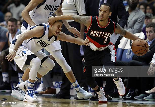 Shabazz Napier of the Portland Trail Blazers dribbles the ball against Seth Curry of the Dallas Mavericks in the second half at American Airlines...