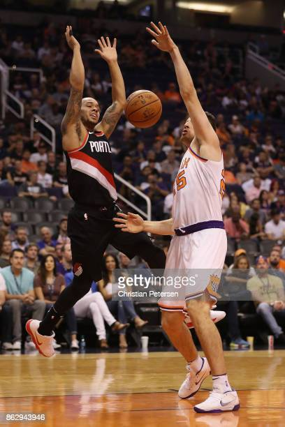 Shabazz Napier of the Portland Trail Blazers looses the ball as he drives against Alec Peters of the Phoenix Suns during the second half of the NBA...