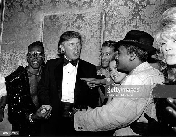 Shabba Ranks Donald Trump Unidentifed Cyndi Lauper Unidentified and Marla Maples pose for a photo at a Grammy Awards party at the Plaza Hotel in...