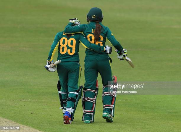 Shabnim Ismail and Sune Luus of South Africa celebrate hitting the winning runs and securing victory during the ICC Women's World Cup group match...