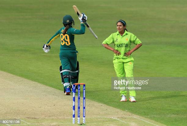 Shabnim Ismail of South Africa celebrates smashing the ball down the ground to win the game as Kainat Imtiaz of Pakistan looks on during the ICC...
