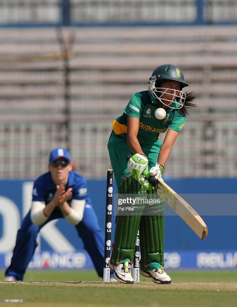 Shabnim Ismail of South Africa gets hit by a ball by Katherine Brunt of England during the Super Sixes match between England and South Africa held at the Barabati stadium on February 10, 2013 in Cuttack, India.