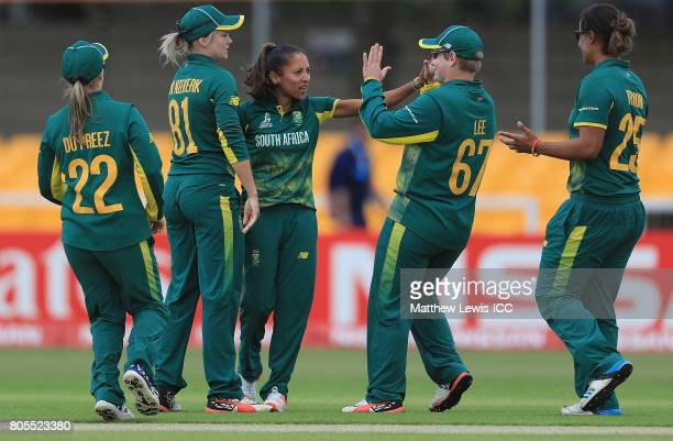 Shabnim Ismail of South Africa is congratulated on the wicket of Hayley Matthews of the West Indies after she was caught by Trisha Chetty during the...