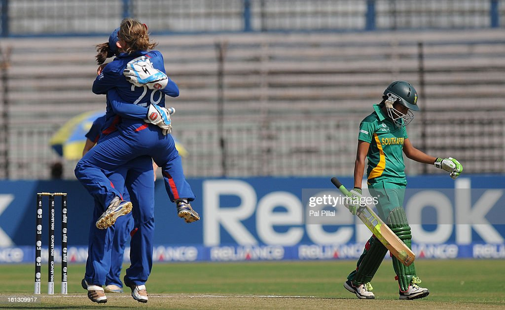 Shabnim Ismail of South Africa walks back as Danielle Wyatt of England celebrates her wicket during the Super Sixes match between England and South Africa held at the Barabati stadium on February 10, 2013 in Cuttack, India.