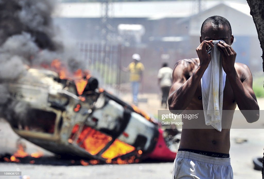 Shacks burn down on January 22, 2013, in Sasolburg, South Africa. Government's announcement of its intention to merge municipal systems in the Free State sparked outrage in locals, leading to chaotic protests.