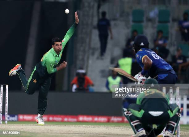 Shadab Khan of Pakistan bowls during the third one day international match between Pakistan and Sri Lanka in Abu Dhabi at Zayed Cricket Stadium on...