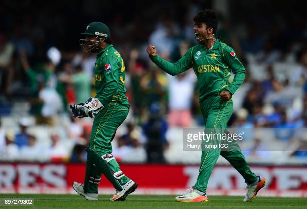 Shadab Khan of Pakistan celebrates the wicket of Kedar Jadhav of India with team mates during the ICC Champions Trophy Final match between India and...