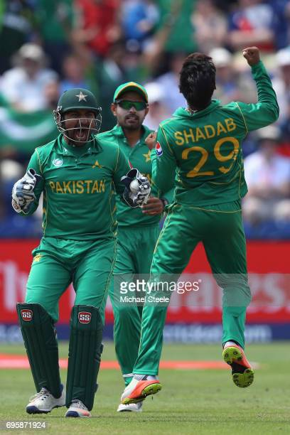 Shadab Khan of Pakistan celebrates with Sarfraz Ahmed after capturing the wicket of Joe Root of England during the ICC Champions Trophy SemiFinal...