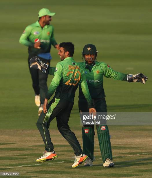 Shadab Khan of Pakistan celebrates with teammates after dismissing Upul Tharanga of Sri Lanka during the third One Day International match between...
