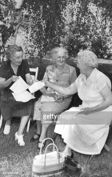 Shade Seeking Ladies Secure from the sun are these busy seamstresses beneath a shade tree They are Mrs Treva Kurtz Mrs Elizabeth Barrett and Mrs Peal...