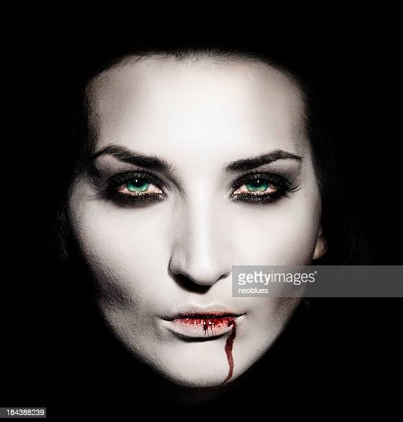 Shaded portrait of a white faced female vampire with blood
