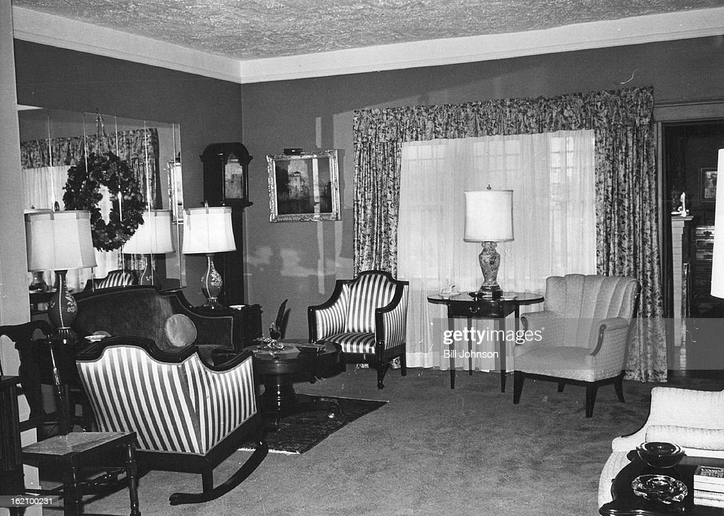 NOV 21 1962, NOV 24 1962; Shades Of Green Make Shooting Background; Victorian loveseat and striped chairs belonged to Mrs. Nims Family and were recovered to go win other furniture. Grandfather's clock has wooden works, made in 1800.;