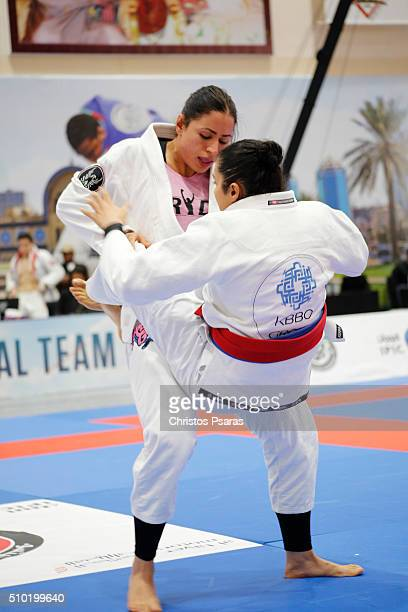 Shadia Bseido of Jordan competes with Ishtar Obaid in women's blue belt open weight semifinals during Sharjah JiuJitsu Open Championship at Sharjah...