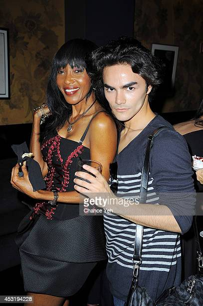 Shadia Elamin and Marco Palou attend Madame Paulette 55th Anniversary and founder John Mahdessian Birthday Party at Beautique on August 4 2014 in New...
