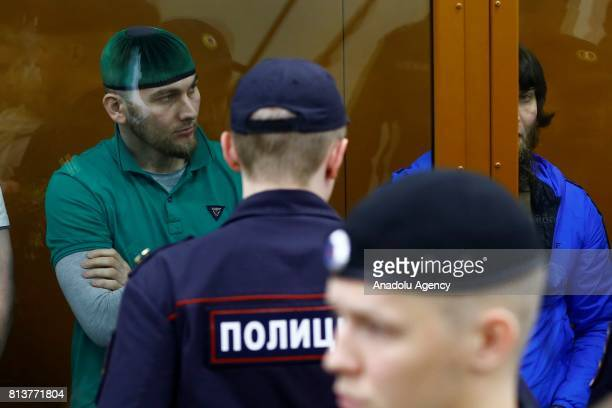 Shadid Gubashev who is convicted of organizing and carrying out the contract killing of opposition leader Boris Nemtsov stand inside a glass...