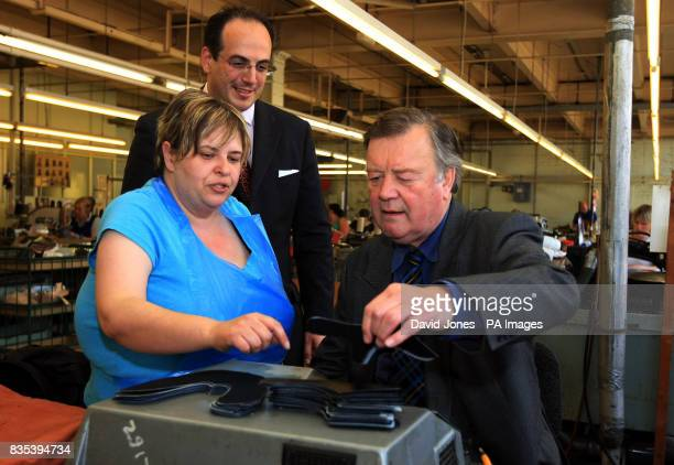 Shadow business secretary Ken Clarke accompanied by Parliamentary candidate Michael Ellis tries his hand at 'skyving' assisted by Lisa Burrows at...