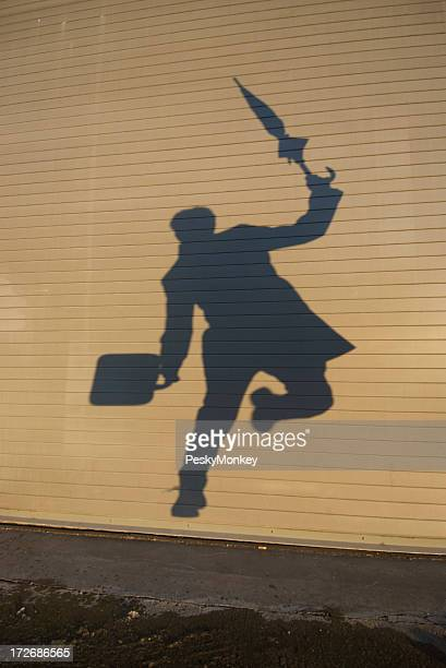 Shadow Businessman Jumps Over Puddle