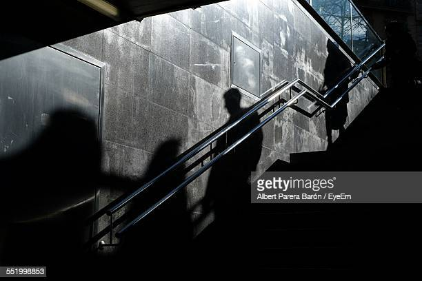 Shadow Casting Of People On Wall