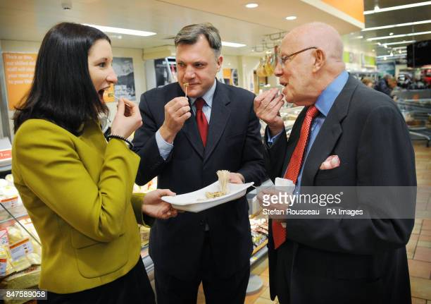 Shadow Chancellor Ed Balls actor and Labour supporter Richard Wilson and shadow chief secretary to the treasury Rachel Reeves try some cheese as they...