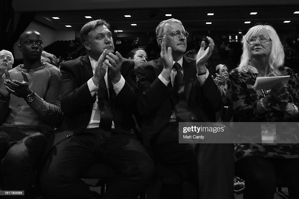 Shadow chancellor Ed Balls (L) and Hilary Benn (R) applaud a speaker at the Labour Party conference on September 25, 2013 in Brighton, England. Today was the last day of opposition Labour Party's annual conference in the southern English coastal town.