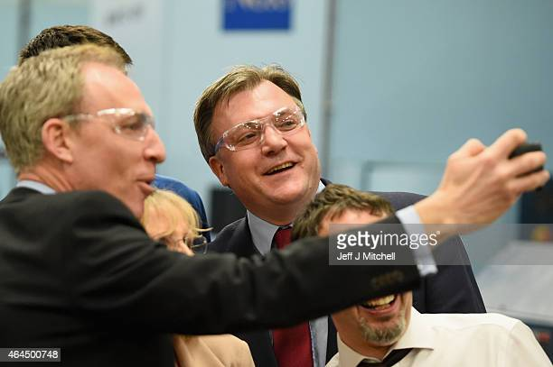 Shadow Chancellor Ed Balls joins Scottish Labour Leader Jim Murphy as he takes a selfie during a visit to Walker Precision Engineering in Curran's...