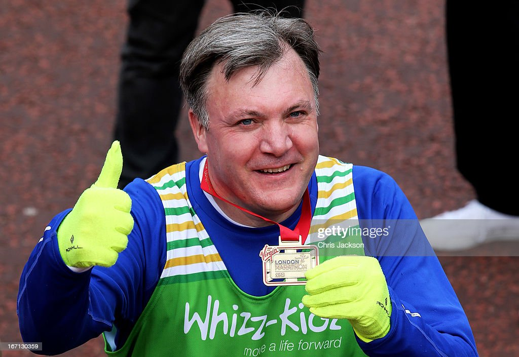 Shadow Chancellor <a gi-track='captionPersonalityLinkClicked' href=/galleries/search?phrase=Ed+Balls&family=editorial&specificpeople=3244683 ng-click='$event.stopPropagation()'>Ed Balls</a> reacts after crossing the finish line during the Virgin London Marathon 2013 on April 21, 2013 in London, England.