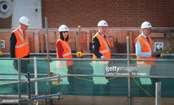 Shadow Chancellor Ed Balls Shadow Chief Secretary to the Treasury Rachel Reeves Terry Morgan Chairman of Crossrail and Sir John Armitt visit the Bond...