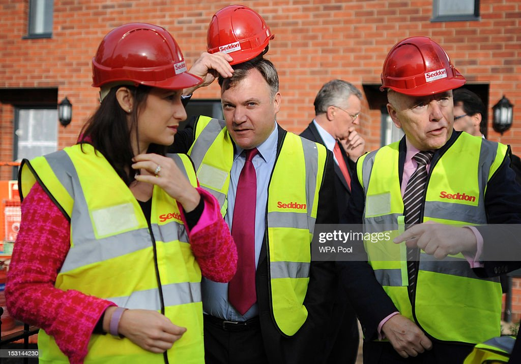 Shadow chancellor <a gi-track='captionPersonalityLinkClicked' href=/galleries/search?phrase=Ed+Balls&family=editorial&specificpeople=3244683 ng-click='$event.stopPropagation()'>Ed Balls</a> (2nd L) visits a social housing project with Labour front bench colleagues Shadow Chief Secretary to the Treasury Rachel Reeves (L) Shadow Housing Minister <a gi-track='captionPersonalityLinkClicked' href=/galleries/search?phrase=Jack+Dromey&family=editorial&specificpeople=4680369 ng-click='$event.stopPropagation()'>Jack Dromey</a> (R) and Shadow Communities Secretary <a gi-track='captionPersonalityLinkClicked' href=/galleries/search?phrase=Hilary+Benn&family=editorial&specificpeople=703088 ng-click='$event.stopPropagation()'>Hilary Benn</a> on the second day of the Labour Party Conference on October 1, 2012 in Manchester, England. Shadow Chancellor <a gi-track='captionPersonalityLinkClicked' href=/galleries/search?phrase=Ed+Balls&family=editorial&specificpeople=3244683 ng-click='$event.stopPropagation()'>Ed Balls</a> is expected to unveil plans today to stimulate the economy using a GBP £3billion windfall from the sale of 4G mobile phone frequencies to build 100,000 affordable homes and give stamp duty breaks to first time buyers.