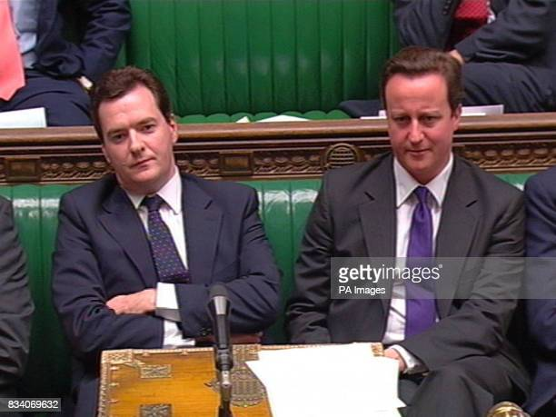 Shadow Chancellor George and Conservative Party leader David Cameron listen as Chancellor Alistair Darling makes a statement to the House of Commons...
