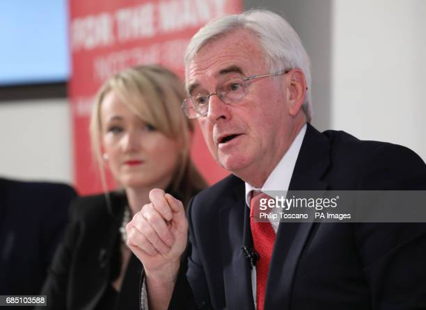Shadow chancellor John McDonnell and shadow business secretary Rebecca LongBailey address a press conference in London to outline the Tories threats...