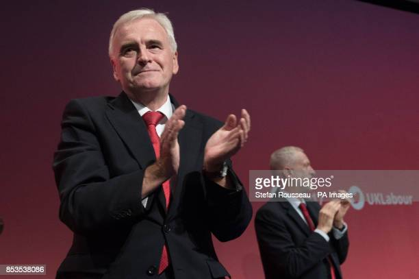 Shadow chancellor John McDonnell applauds the audience after addressing the Labour Party annual conference at the Brighton Centre Brighton