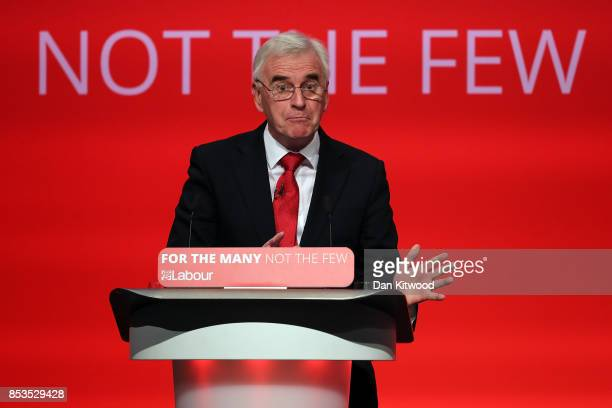 Shadow Chancellor John McDonnell delivers his keynote speech in the main hall during day two of the Labour Party Conference on September 25 2017 in...