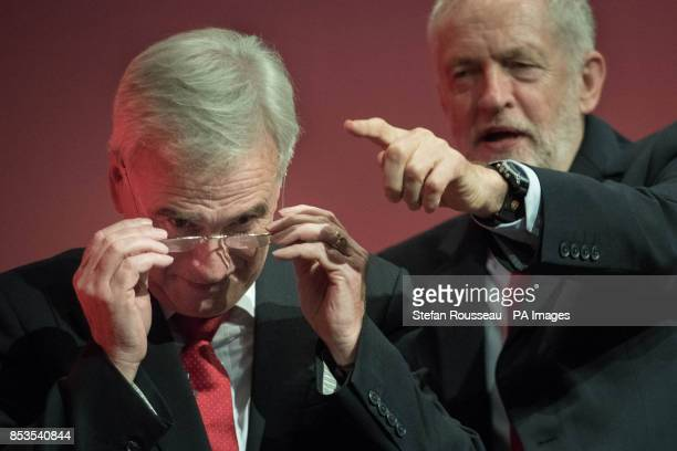Shadow chancellor John McDonnell is congratulated by Labour leader Jeremy Corbyn after addressing the Labour Party annual conference at the Brighton...