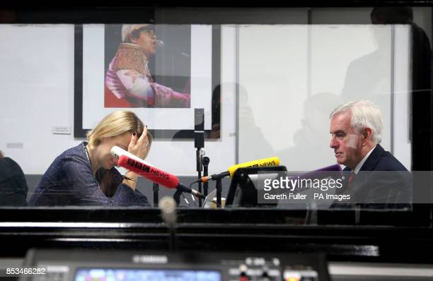 Shadow Chancellor John McDonnell speaks to the BBC's Laura Kuenssberg during radio interviews at the Labour Party annual conference at the Brighton...