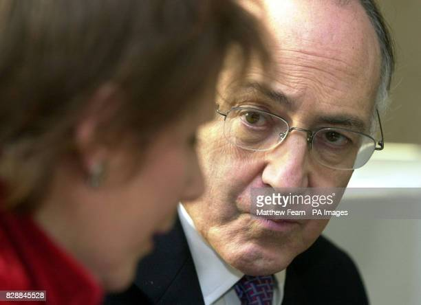 Shadow chancellor Michael Howard speaks with charity founder Marjorie Wallace during a visit to the SANE mental health charity in London Mr Howard...