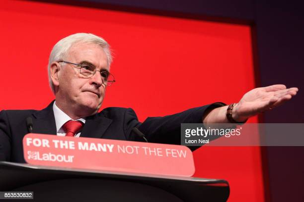 Shadow Chancellor of the Exchequer John McDonnell addresses delegates in the main hall on the second day of the Labour Party conference on September...