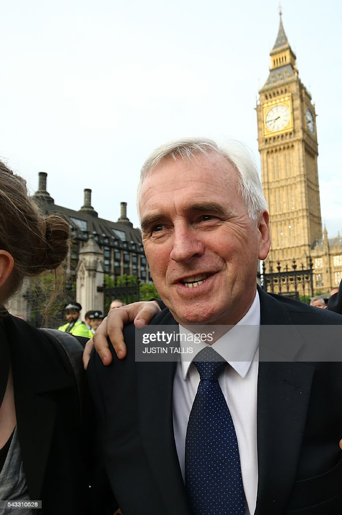 Shadow Chancellor of the Exchequer John McDonnell arrives to deliver a speech outside parliament during a pro-Corbyn demonstration in central London on June 27, 2016. Britain's historic decision to leave the 28-nation bloc has sent shockwaves through the political and economic fabric of the nation. It has also fuelled fears of a break-up of the United Kingdom with Scotland eyeing a new independence poll, and created turmoil in the opposition Labour party where leader Jeremy Corbyn is battling an all-out revolt. TALLIS
