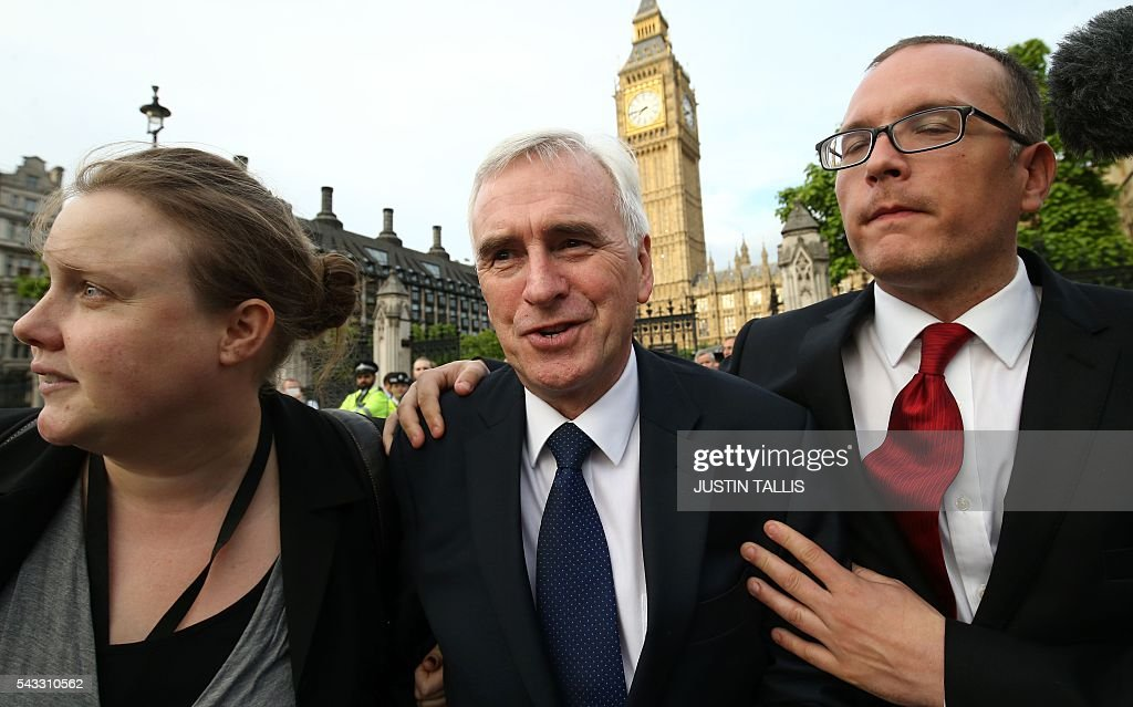 Shadow Chancellor of the Exchequer John McDonnell (C) arrives to deliver a speech outside parliament during a pro-Corbyn demonstration in central London on June 27, 2016. Britain's historic decision to leave the 28-nation bloc has sent shockwaves through the political and economic fabric of the nation. It has also fuelled fears of a break-up of the United Kingdom with Scotland eyeing a new independence poll, and created turmoil in the opposition Labour party where leader Jeremy Corbyn is battling an all-out revolt. TALLIS