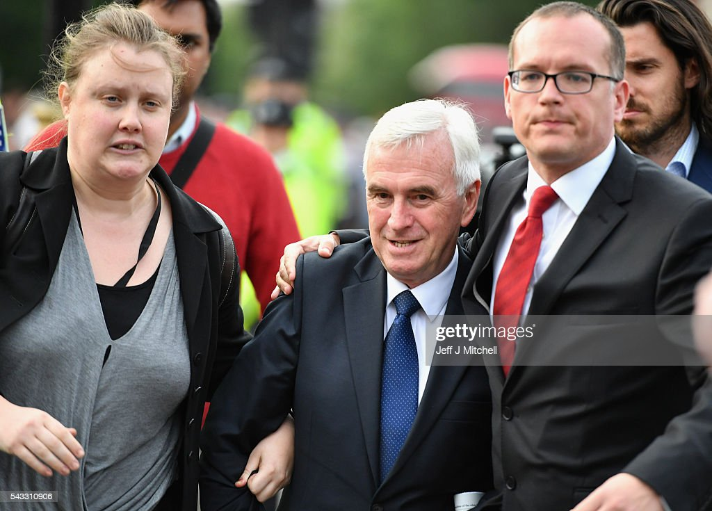 Shadow Chancellor of the Exchequer <a gi-track='captionPersonalityLinkClicked' href=/galleries/search?phrase=John+McDonnell+-+Politician&family=editorial&specificpeople=15046200 ng-click='$event.stopPropagation()'>John McDonnell</a> attends Momentum's 'Keep Corbyn' rally outside the Houses of Parliament on June 27, 2016 in London, England. The Labour Leader has seen mass resignations from the Shadow Cabinet in the wake of the UK Vote for Brexit. His support group, Momentum, have recorded more than 1000 new members in the same period.