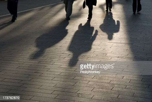 Shadow Commuters Businessmen Outdoors on Smooth Modern Walkway