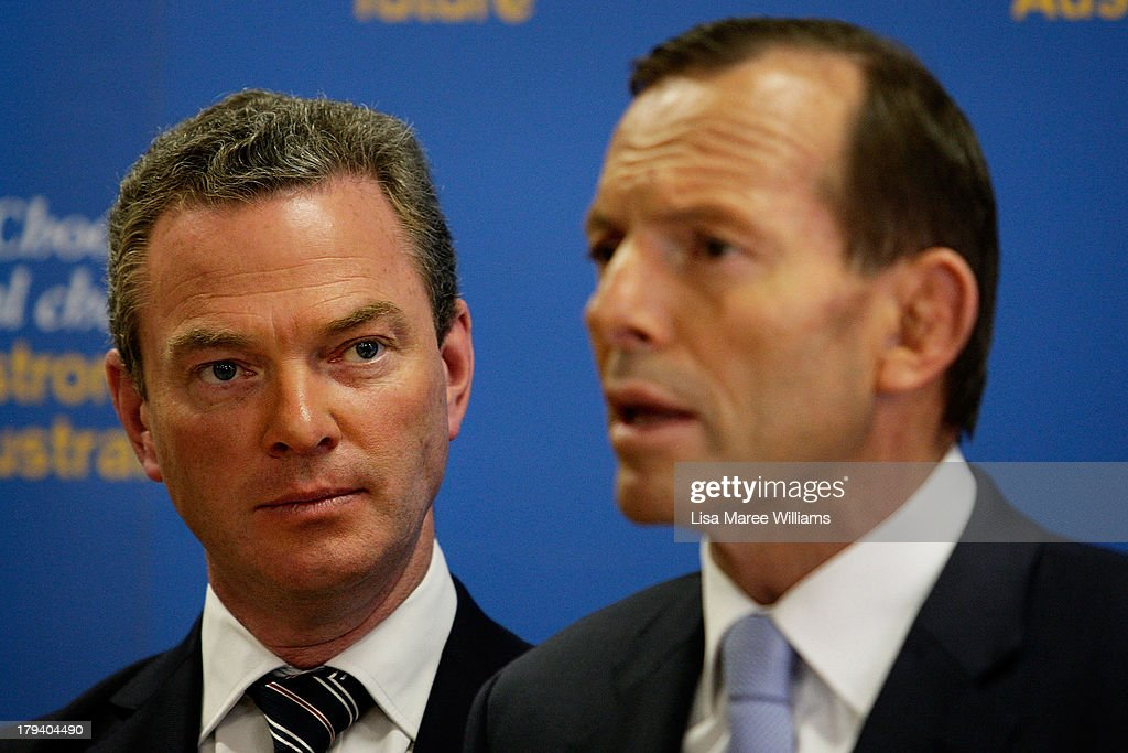 Shadow Education minister, Christopher Pyne stands with Australian Opposition Leader, <a gi-track='captionPersonalityLinkClicked' href=/galleries/search?phrase=Tony+Abbott&family=editorial&specificpeople=220956 ng-click='$event.stopPropagation()'>Tony Abbott</a> as he speaks to workers and the media at Penrice Soda Holdings on September 3, 2013 in Adelaide, Australia. In the 2010 election the Australian Labor Party recorded its highest two-party-preferred vote since 1969 in South Australia, but if nationwide polling proves accurate the Liberal-National Party coalition believe they can gain seats in the state.