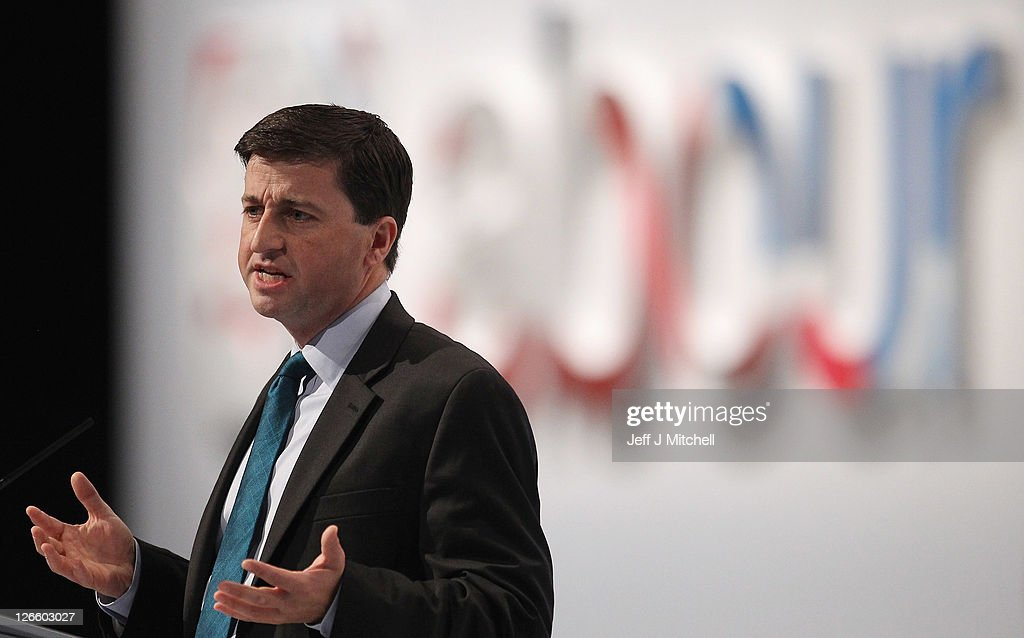 Shadow Foreign Secretary <a gi-track='captionPersonalityLinkClicked' href=/galleries/search?phrase=Douglas+Alexander&family=editorial&specificpeople=616758 ng-click='$event.stopPropagation()'>Douglas Alexander</a> addresses the Labour party conference at the Echo Arena on September 26, 2011 in Liverpool, England. Shadow chancellor Ed Balls gave a keynote speech to delegates and announced a five point plan to boost jobs and economy.