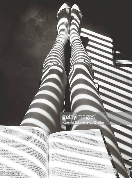 Shadow From Blinds On Womans Legs