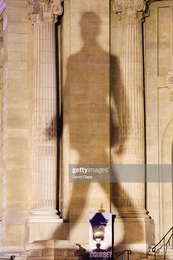 Shadow from Charles de Gaulle statue on the Champs-Elysées, Paris, France : Stock Photo