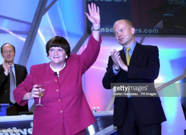 Shadow Home Secretary Ann Widdecombe enjoys a glass of champagne with Tory leader William Hague after delivering her speech on her birthday to the...