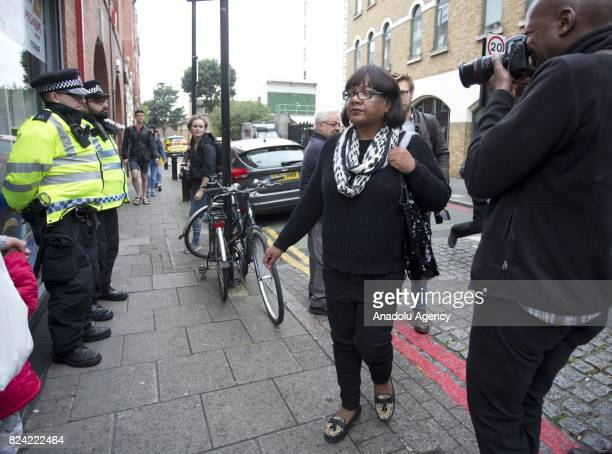 Shadow Home Secretary Diane Abbott joins protesters in a vigil for Rashan Charles outside Stoke Newington Police Station in London England on July 29...
