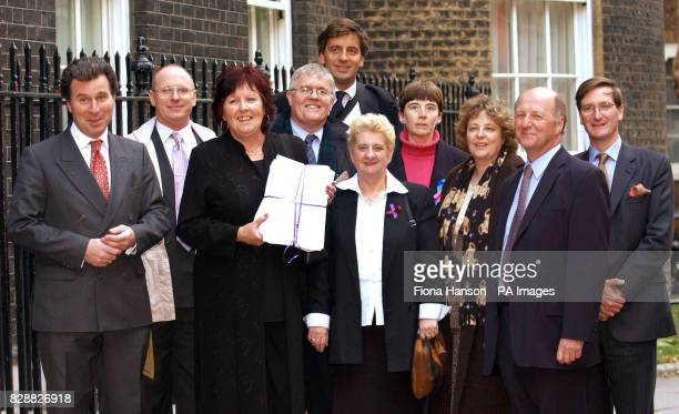 Shadow Home Secretary Oliver Letwin accompanies members of the Coalition For Equal Parenting from second left Paul Duffield Anne Harris Stephen...