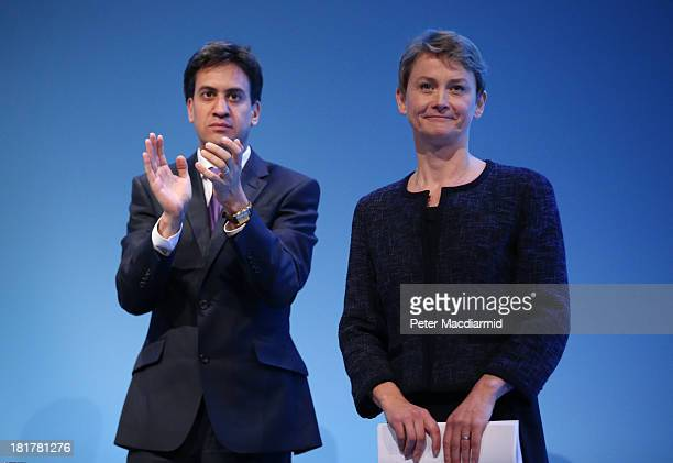Shadow home secretary Yvette Cooper is applauded by party leader Ed Miliband after speaking at the Labour Party conference on September 25 2013 in...
