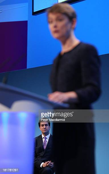 Shadow home secretary Yvette Cooper is watched by party leader Ed Miliband as she speaks at the Labour Party conference on September 25 2013 in...